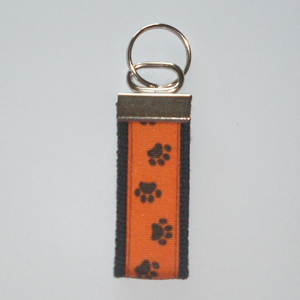 Pawprints on Orange Black Trim